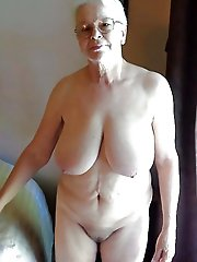 Sensational old female taking off her dress