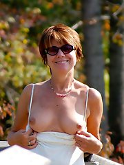 Big breasted older cougar posing nude