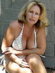 Pervert mature women are posing seminaked for a photoshoot