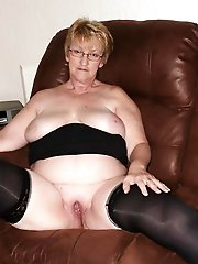 Delicious aged mistress posing naked on camera